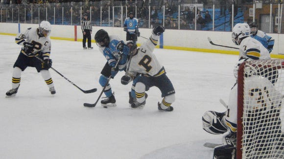 Suffern forward Harrison Gdanski battles Pelham defenseman Connor Evans for a puck in the slot in the second period of Thursday's game.