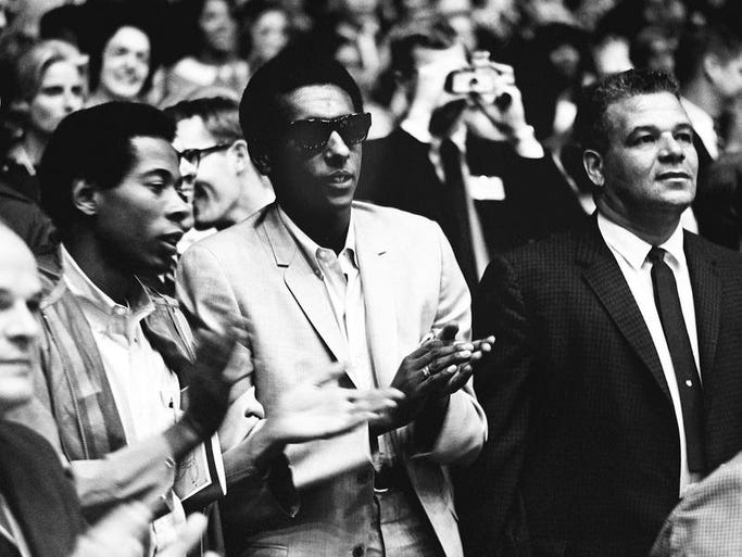 Stokely Carmichael, center, the militant leader of the Student Nonviolent Coordinating Committee, claps for a speaker on the first day of the Impact symposium at Vanderbilt University April 4, 1967. The next day, Carmichael will speak to the crowd.