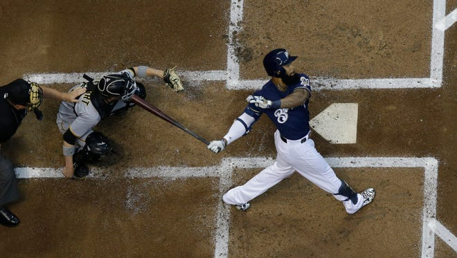 Milwaukee Brewers first baseman Eric Thames hits a home run against the Pittsburgh Pirates Tuesday night at Miller Park.