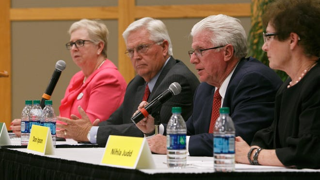 Candidates for Utah House District 74, Dorothy Engelman (D) and Lowry Snow (R) and District 75 candidates Don Ipson (R) and Nihla Judd (I), from left to right debate the issues in 2014 on the campus of Dixie State University.