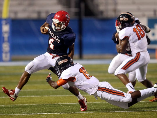 Oakland's Lazarius Patterson runs the ball as Hoover's