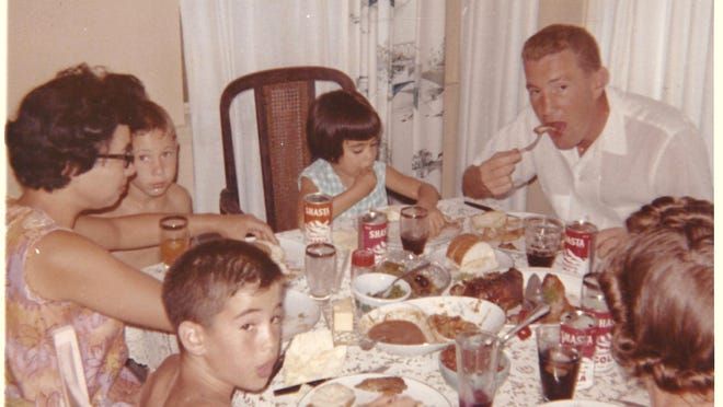 Dominic Savino loved to gather his family around the dinner table. Savino (right) sits with his family in 1964.
