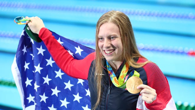 Lilly King poses with an American flag and her gold medal after the women's 100m breaststroke final during the Rio 2016 Summer Olympic Games at Olympic Aquatics Stadium.