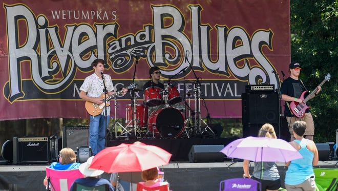 Members of Slim Jeezy and the Feelgood Band perform during the River and Blues Fest in Wetumpka, Ala. on Saturday July 22, 2017.