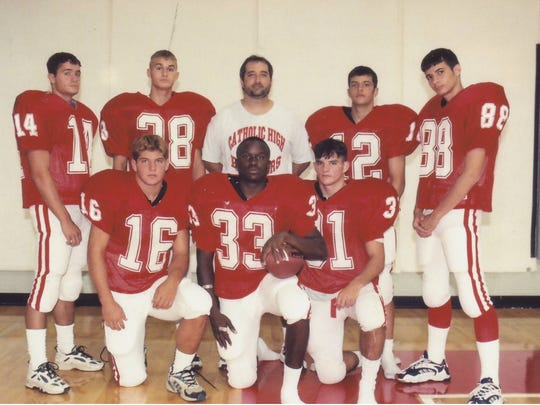Coach David Comeaux with his Panthers' offensive leaders as the Catholic High of New Iberia offensive coordinator back in 1996.