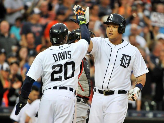 Detroit Tigers' Rajai Davis congratulates Miguel Cabrera