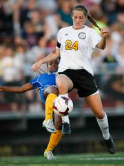 Padua's Regan Lehman jumps to intercept the ball from Caesar Rodney's Janiah Moore.