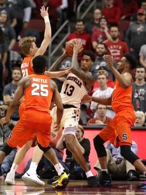 Louisville's Ray Spalding is trapped under the basket by Syracuse defenders.  Feb. 5, 2018.