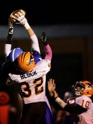 Amherst's Joshua Schude catches a pass despite and