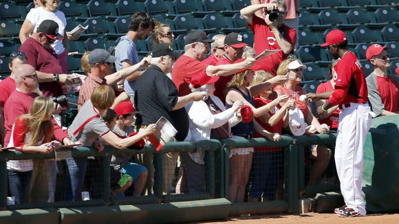 Reds second baseman Brandon Phillips signs autographs