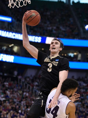 March 16, 2017: Vanderbilt Commodores forward Luke Kornet (3) moves to the basket against Northwestern Wildcats guard Sanjay Lumpkin (34) during the second half in the first round of the NCAA tournament at Vivint Smart Home Arena.