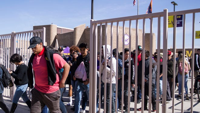 Students at Mesa High School walk out of class at noon Feb. 21, 2018, to protest the Florida shootings.
