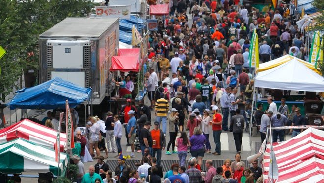 Crowds gather on 5th Street near Fountain Square during 2013 Oktoberfest Zinzinnati.