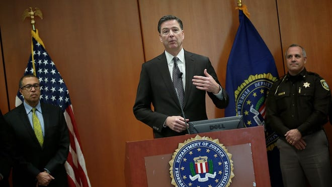 FBI Director James Comey speaks during a press conference on Tuesday, April 5, 2016, at the Federal Reserve Bank in Detroit, MI.