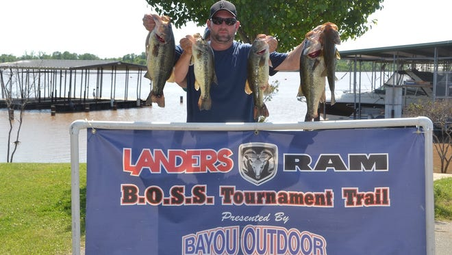 Brent Stewart gets some mysterious help in displaying the five bass that helped him and Kevin McGowen win Saturday's Landers/Ram event with 20.92 pounds.