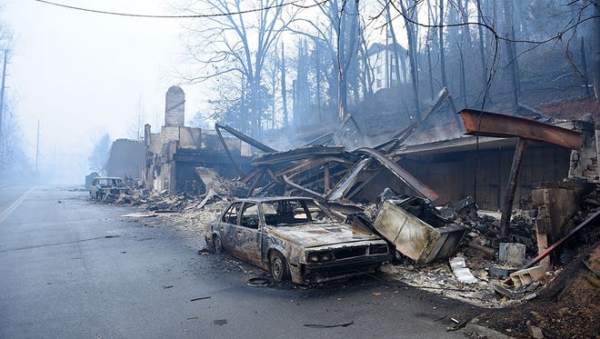 Wildfires have burned multiple businesses and vehicles like these along Cherokee Orchard Road in Gatlinburg.