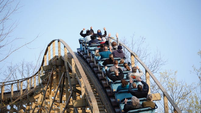 Mystic Timbers, a new roller coaster, crests a hill at Kings Island on Thursday. The ride opens to the public Saturday.