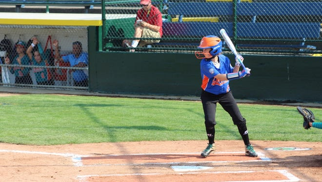 Kate Weber bats during Floyds Knobs' opening 10-0 win against Puerto Rico at the Little League Softball World Series in Portland, Oregon.