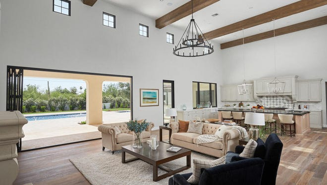 Matthew Neal, a neurosurgeon practicing in Phoenix, and his wife Grace, a real estate appraiser, purchased this 5,814-square-foot mansion in Scottsdale's Equestrian Manor community.
