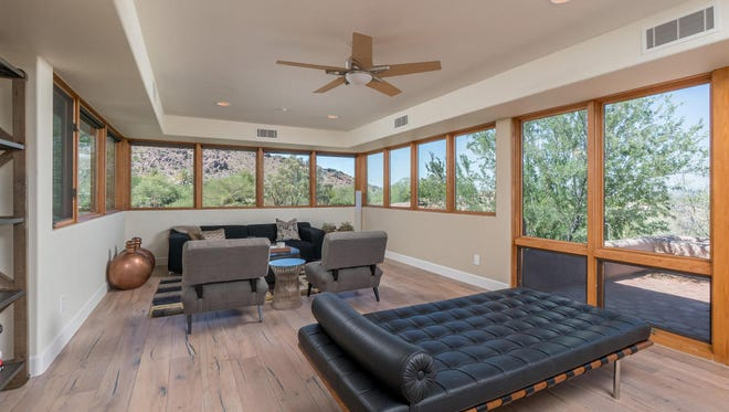 Shirryn Padilla, territory manager at Singlewire Software, and her husband Brianpaid cash for this new 5,286-square-foot house in Paradise Valley's Mummy Mountain Park community.