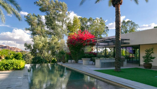 Russell Grossman, owner of BNG Enterprises Inc., and his wife, Robin,purchased this 7,767-square-foot contemporary-style mansion in Paradise Valley's Metes and Bounds community.