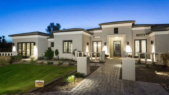 Eric Chavez, former third basemen for the Arizona Diamondbacks, and his wife, Alexandra, sold this 6,403-square-foot contemporary-style mansion in Paradise Valley's Paradise Country Estates.