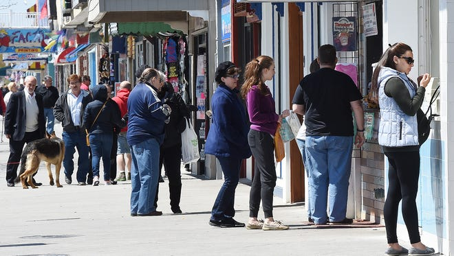 Businesses in Rehoboth Beach and Dewey Beach are preparing for the upcoming summer season by placing signs notifying the public of opening dates and asking for help wanted.