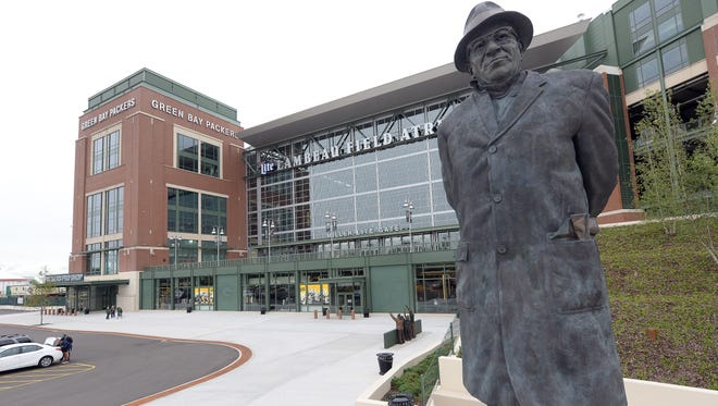The statue of Vince Lombardi stands on Harlan Plaza awaiting the crowds for Sunday's home opener for the Green Bay Packers at Lambeau Field on Friday.