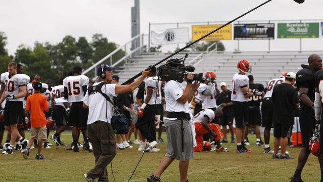 """'Hard Knocks'  """"Hard Knocks""""  HBO camped with the Bengals in Georgetown in 2009.  Members of HBO's """"Hard Knocks"""" crew make their way around the field gathering sights and sounds of the Cincinnati Bengals during the morning practice."""