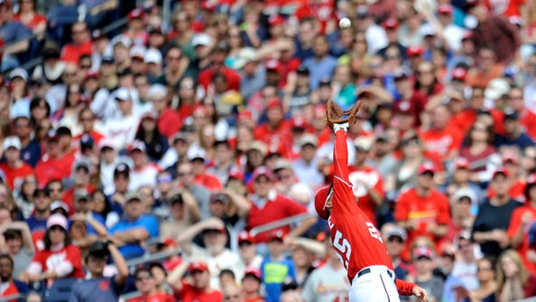 Apr 19, 2014; Washington, DC, USA; Washington Nationals first baseman Adam LaRoche (25) catches a pop-up in foul territory in the eighth inning against the St. Louis Cardinals at Nationals Park. The Cardinals defeated the Nationals 4-3. Mandatory Credit: Joy R. Absalon-USA TODAY Sports