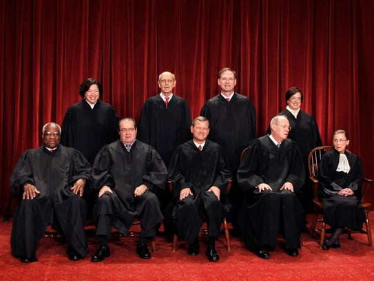 In this Oct. 8, 2010 photo, the Supreme Court justices