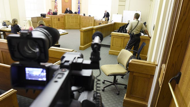 Cameras are used in a civil trial in 2015.