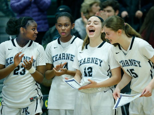 Bishop Kearney celebrates a 58-39 win over Orchard Park at Rush-Henrietta High School.