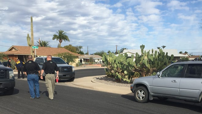 Investigators examine the crime scene after a MCSO deputy shot and killed a Sun City man after he pulled out a gun during negotiations.