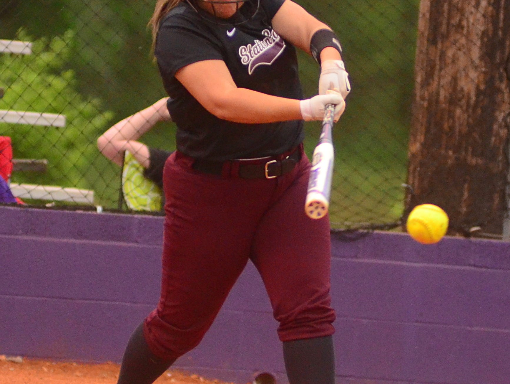 Station Camp High junior Madelyne Puckett singles during first-inning action.