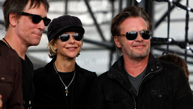 John Mellencamp, right, and Meg Ryan, center, watch Dale Watson perform at the start of  Farm Aid 2012 concert at Hersheypark Stadium in Hershey, Pa.