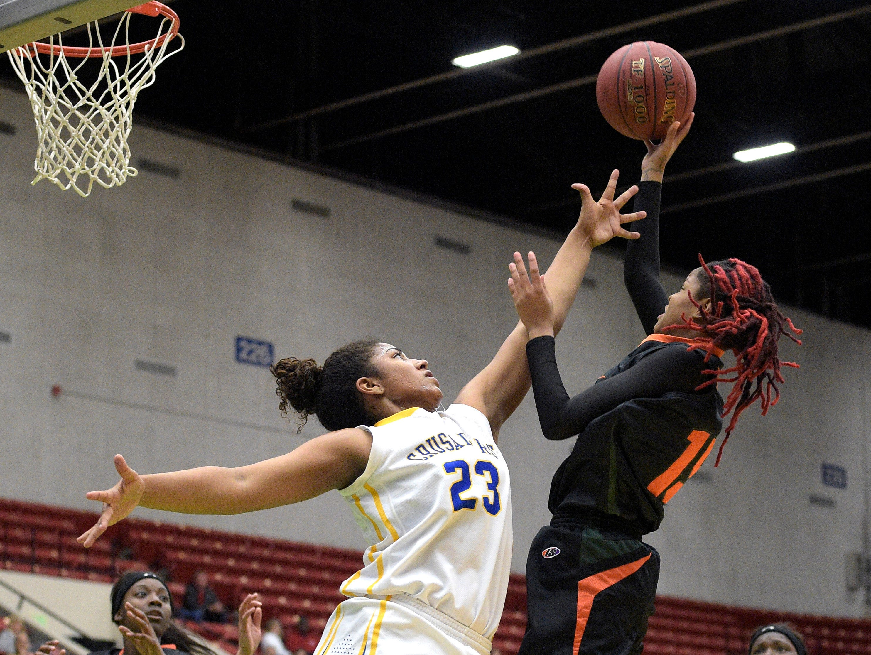 Dunbar's Dekeriya Patterson (15) puts up a shot in front of Cardinal Newman's Milan Morris (23) during a girls basketball game at the FHSAA State Finals, Tuesday, Feb. 17, 2015, in Lakeland, Fla.(Photo/Phelan M. Ebenhack)
