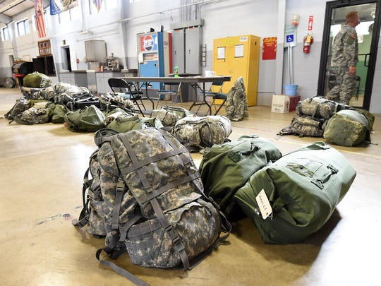 Gear sits on the armory floor of the Arkansas Army National Guard's 224th Maintenance Company on Wednesday. Guardsmen were preparing for a three-week training mission in California.