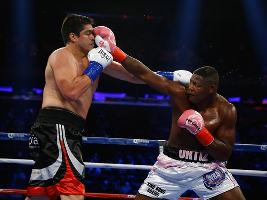 NEW YORK, NY - OCTOBER 17:  Luis Ortiz punches Matias Ariel Vidondo during their WBA Interim Heavyweight title fight at Madison Square Garden on October 17, 2015 in New York City.  (Photo by Al Bello/Getty Images) ORG XMIT: 567656971 ORIG FILE ID: 493144740