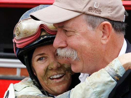 Jockey Andrea Seefeldt Knight, left, embraces horse owner Jim Macko after she won atop Zuerstgold during the Lady Legends for the Cure horse race at Pimlico Race Course, Friday, May 16, 2014, in Baltimore. The 139th Preakness horse race takes place Saturday. (AP Photo/Garry Jones)