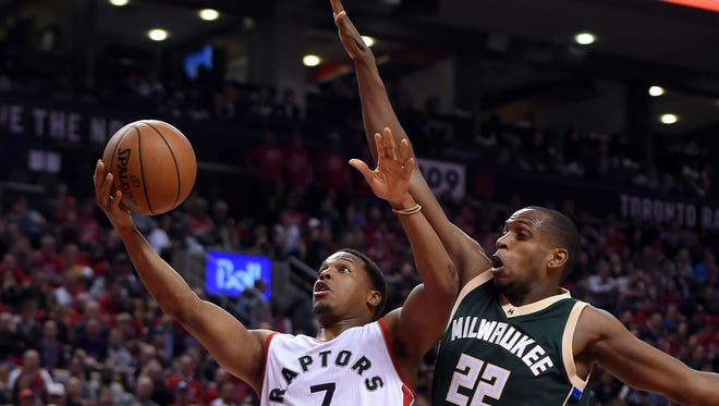 Raptors guard Kyle Lowry goes up for a layup against Bucks forward Khris Middleton in the second half of Toronto's Game 2 victory on Tuesday night.