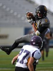 Galena's Bryan Madison (2) makes a catch over Lassen's