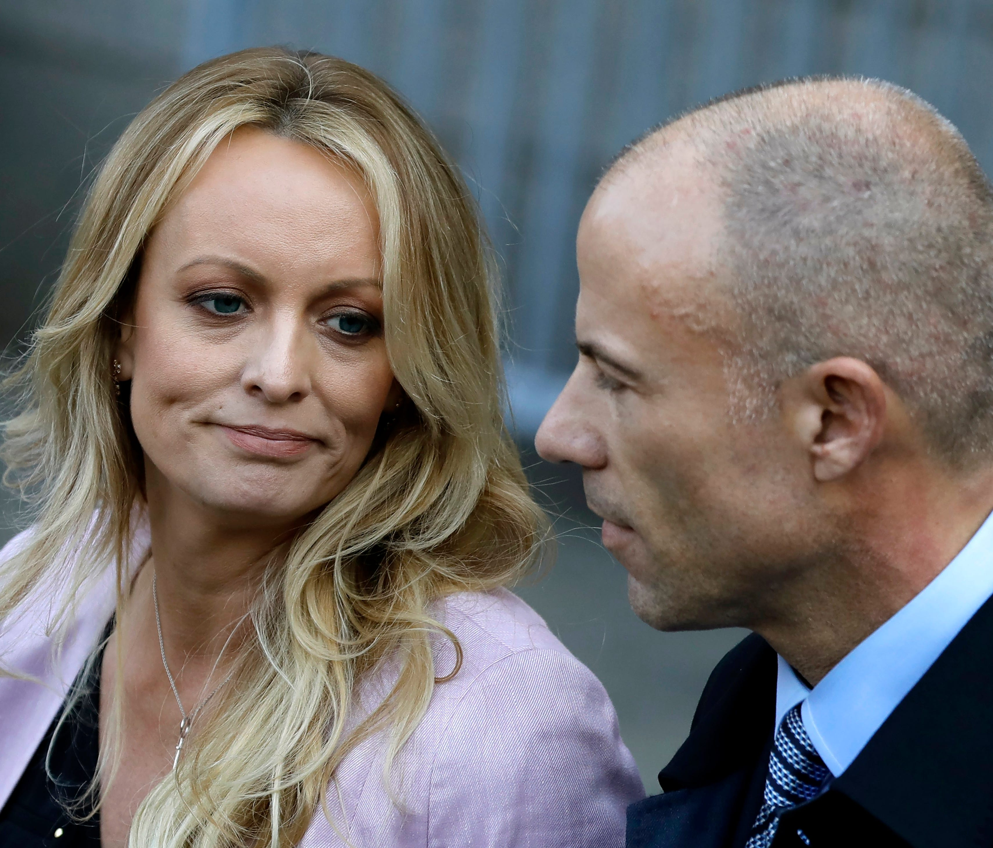 Stormy Daniels, also known as Stephanie Clifford, speaks to reporters with her attorney Michael Avenatti outside of federal court in New York City April 16.