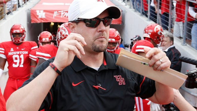 Tom Herman, seen here in a file photo, posted a screenshot of his phone -- and hundreds of unread messages.