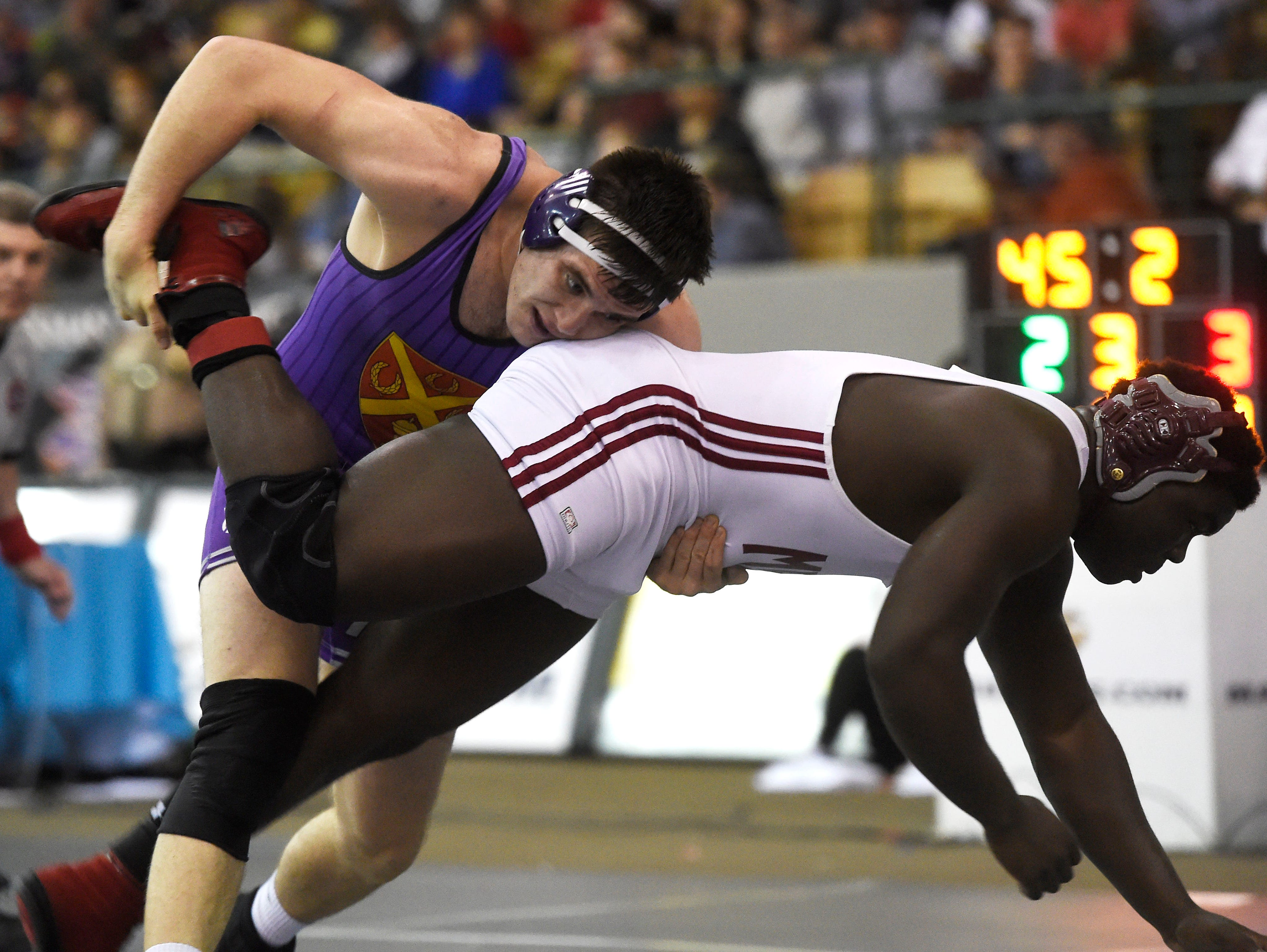 Ben Stacey (Ryan) takes down DÕOn Coofer (MBA) at the TSSAA state wrestling championships Saturday Feb. 20, 2016, in Franklin, Tenn.