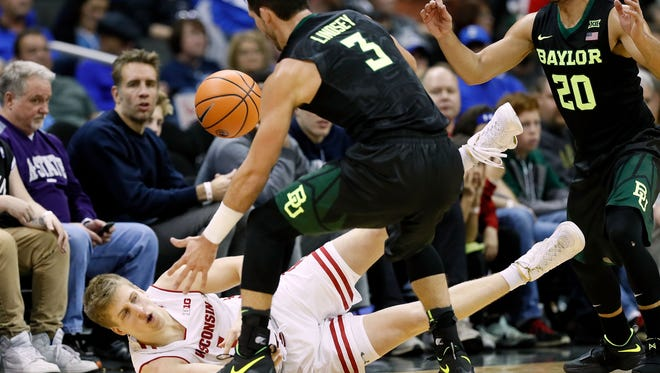 Brevin Pritzl of the Wisconsin Badgers and Jake Lindsey of the Baylor Bears compete for a loose ball during the National Collegiate Basketball Hall of Fame Classic semifinal game at the Sprint Center on Nov. 20, 2017, in Kansas City, Mo.