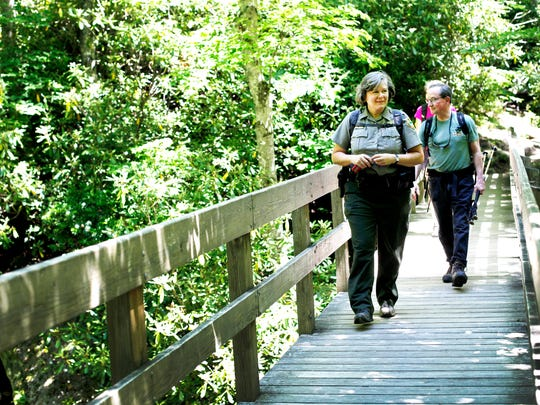 Sue McBean, superintendent of Grandfather Mountain State Park and writer Randy Johnson hike at Grandfather Mountain June 10.