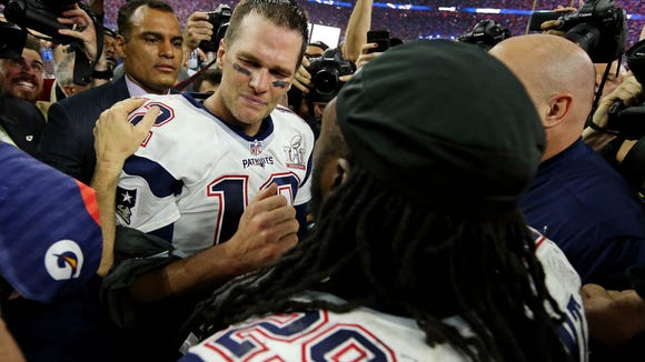 Tom Brady and LeGarrette Blount celebrate the Patriots'