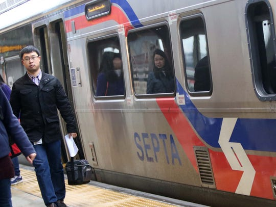 Commuters exit a northbound SEPTA train in this 2016 photo.