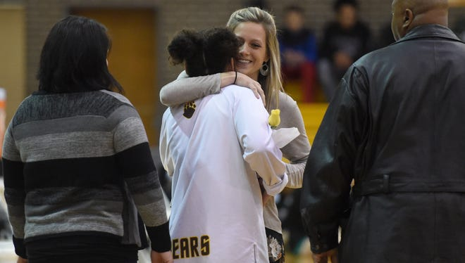 Central head coach Brittany Maners gives a hug to senior Mykiah Jones after she is introduced before the game against North at Central High School in Evansville Thursday. Central won the SIAC regular season title for the second straight year with a 57-38 victory Thursday.